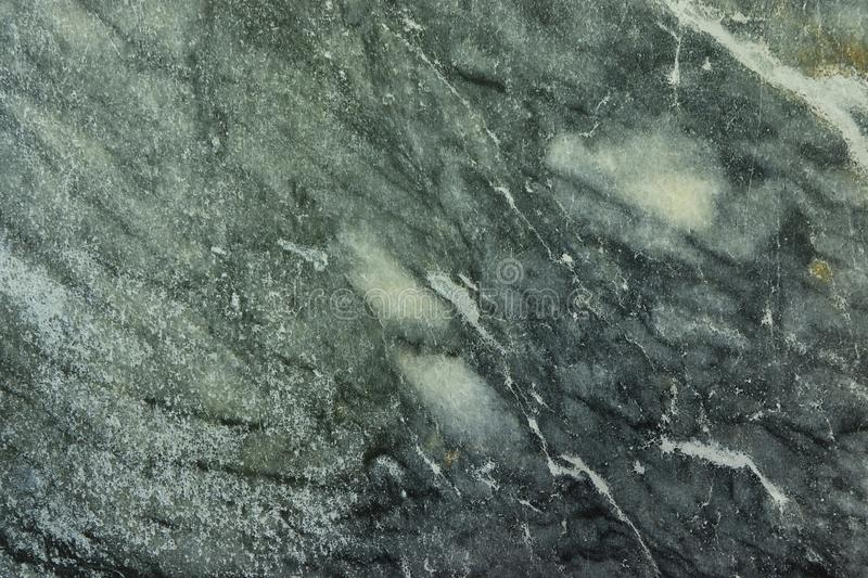 Natural marble background, natural natural texture of an ancient stone. It is used for finishing buildings and embankments, a fine background for a desktop and royalty free stock images