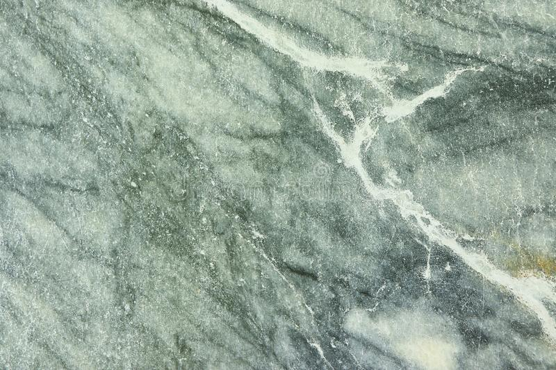 Natural marble background, natural natural texture of an ancient stone. It is used for finishing buildings and embankments, a fine background for a desktop and royalty free stock photos