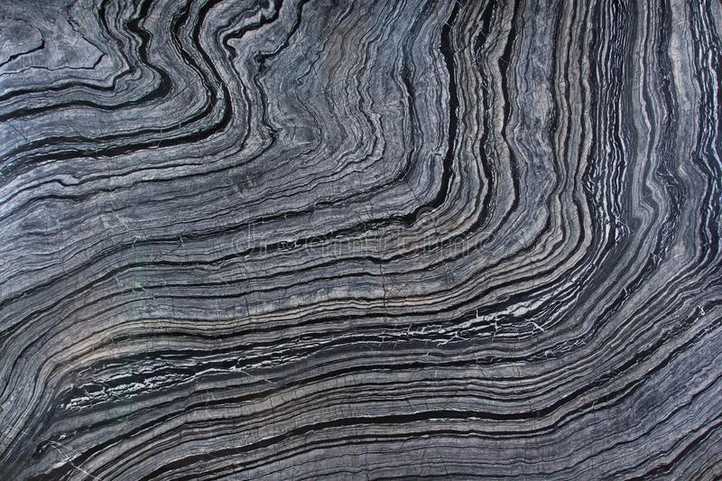 Natural marble is a gray stone with dark stripes called Silver Wave stock photo