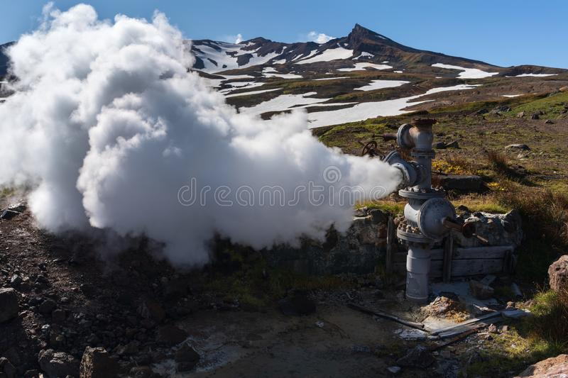 Natural mineral thermal steam-water emission from well, geothermal deposit area stock photos