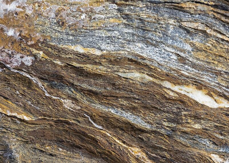 Natural rock background. Sedimentary rock layers. Natural of multi-colored rock background. Sedimentary rock layers at day on sea stock image