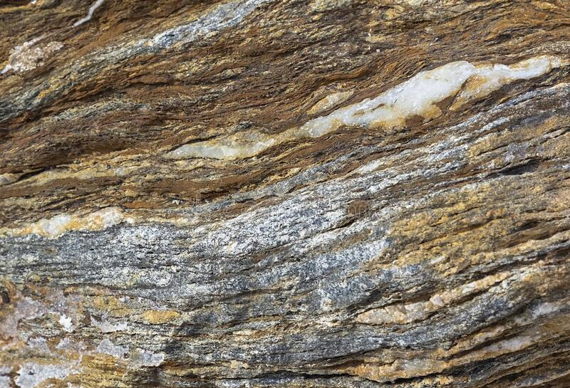 Natural rock background. Sedimentary rock layers. Natural of multi-colored rock background. Sedimentary rock layers at day on sea stock photo