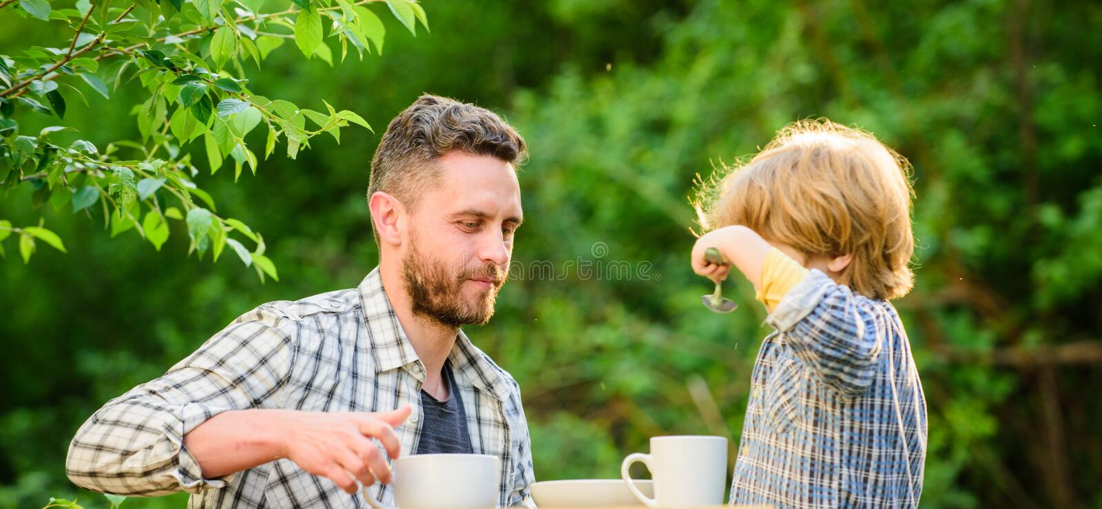 Natural nutrition concept. Feeding son natural foods. Stage of development. Healthy food. Dad and boy eat and feed each stock photos