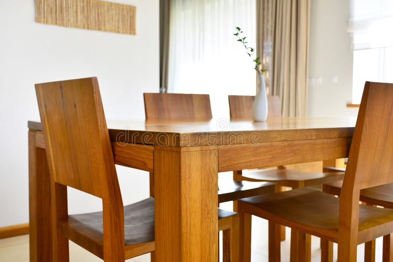 Natural oak wood dining table and chairs in neutral modern inter. Ior design house stock images