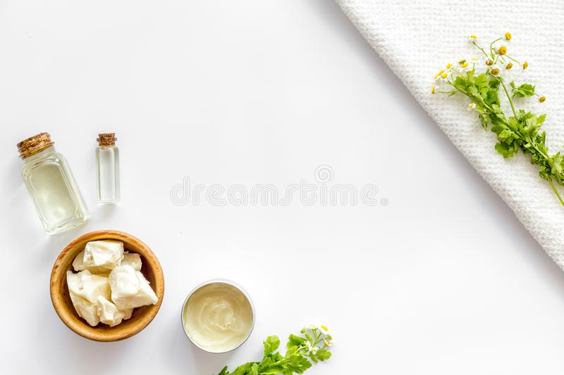 Natural oil for hair on white background top view copyspace. Natural jojoba, argan, coconut oil for hair on white background top view copyspace stock image