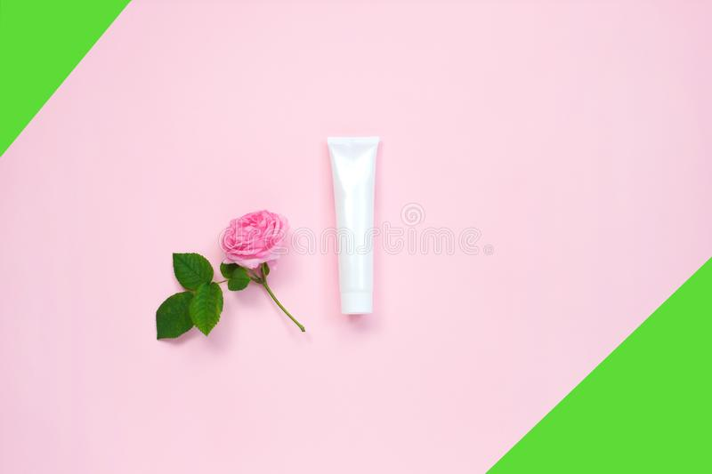 Natural organic cosmetic packaging mock up with flower on color background. Mock-up bottle for branding and label stock photos