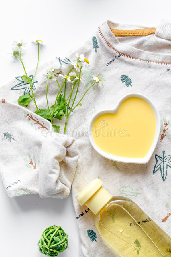 Natural organic cosmetics for baby on white background top view. Natural organic cosmetics for baby with chamomile on white background top view stock photography