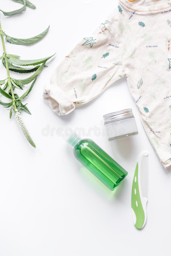 Natural organic cosmetics for baby on white background top view. Natural organic cosmetics for baby with chamomile on white background top view royalty free stock photos
