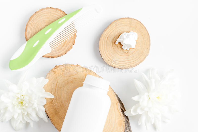 Natural organic cosmetics for baby on white background top view. Natural organic cosmetics for baby with herb on white background top view royalty free stock photography