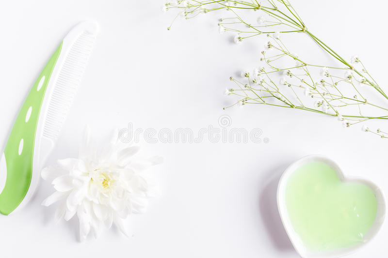 Natural organic cosmetics for baby on white background top view. Natural organic cosmetics for baby with herb on white background top view stock photos