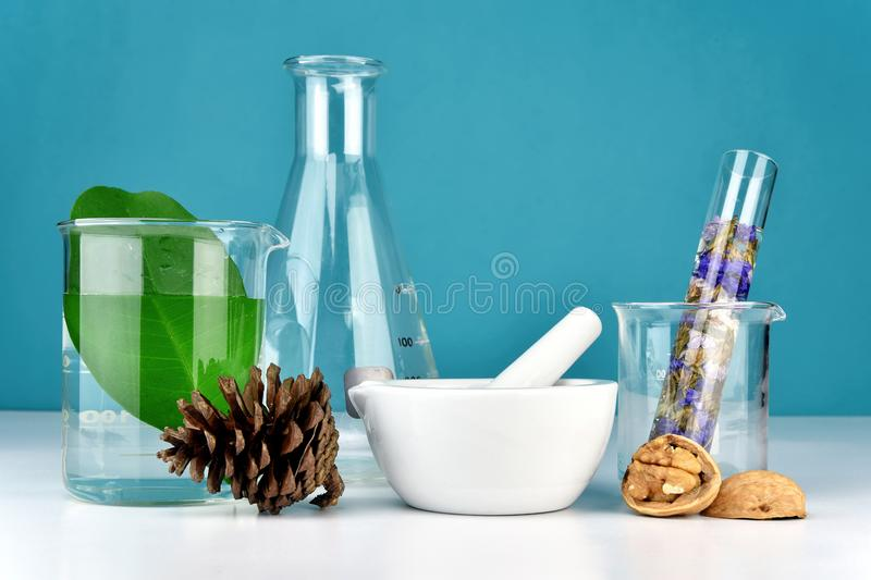 Natural organic medicine and healthcare, Alternative plant medicine, Mortar and herbal extraction. Natural organic medicine and healthcare, Alternative plant stock images