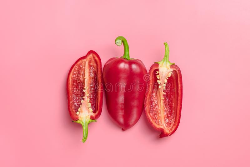 Natural organic red bulgarian bell pepper on trend pink background.Top view.Healthy food concept. Flat lay.Copy space. Minimalism. Style.Vegetables Vitamins royalty free stock image