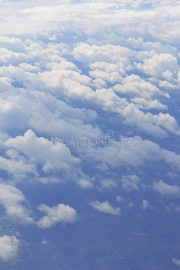Natural panorama of blue sky with light clouds from plane. Concept of air transport, travel, tourism, business. Environmental. Problem of gas pollution royalty free stock photo