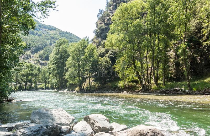 Natural panorama of the river Noguera Pallaresa with strong currents, typical of summer. Catalan Pyrenees. Catalonia, Spain. Natural panorama of the river stock photo