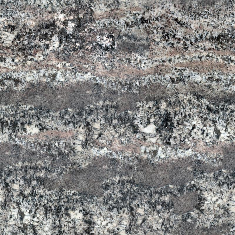 A natural pattern of a granite stone surface. Seamless square background, tile ready. stock photo