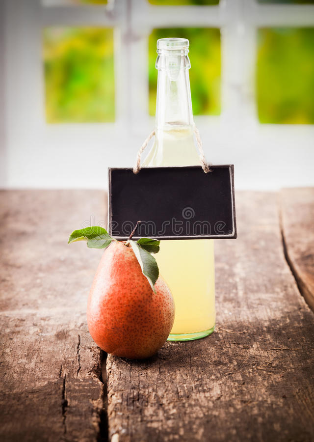 Download Natural pear juice display stock photo. Image of antique - 26007226
