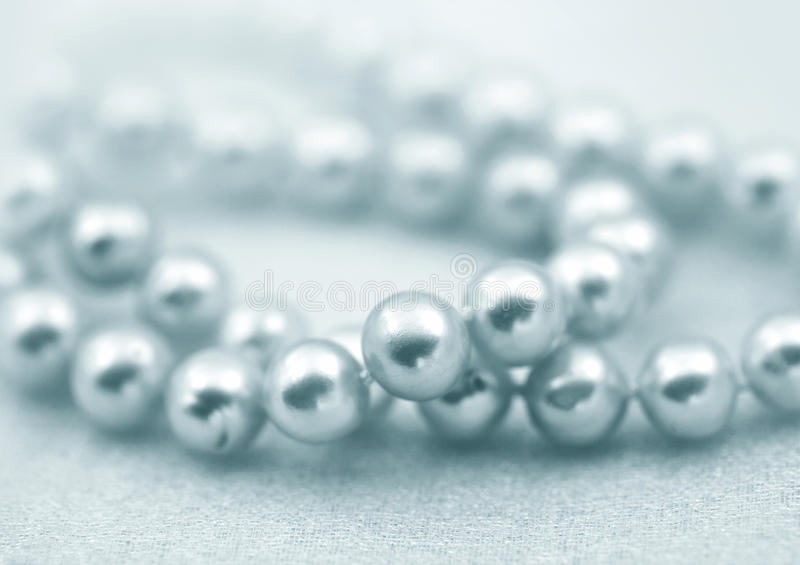 Natural pearl beads. Elegant jewalry beads with jewel stone sea white pearl, soft focus royalty free stock photo