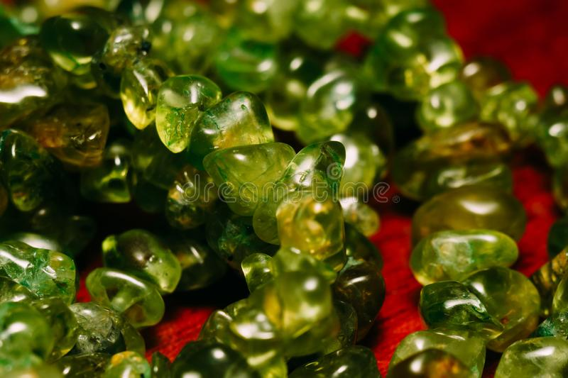 Natural Peridot gravel. August birthstone olive green peridot, natural stone gravel close up royalty free stock image