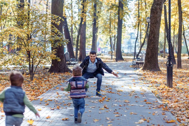 Natural pictures of a happy family of four having fun outsiade on a sunny autumn day. Togetherness and happiness concept stock images