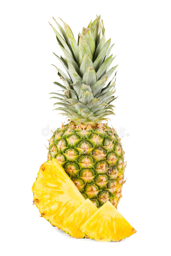 Natural pineapple with white background. Natural pineapple with cut up pieces and white background royalty free stock photo