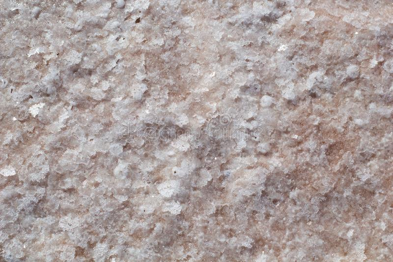 Natural pink salt crystal texture, macro, close up, lamellar structure. Salty lake shore background. Spain, Torrevieja royalty free stock photography