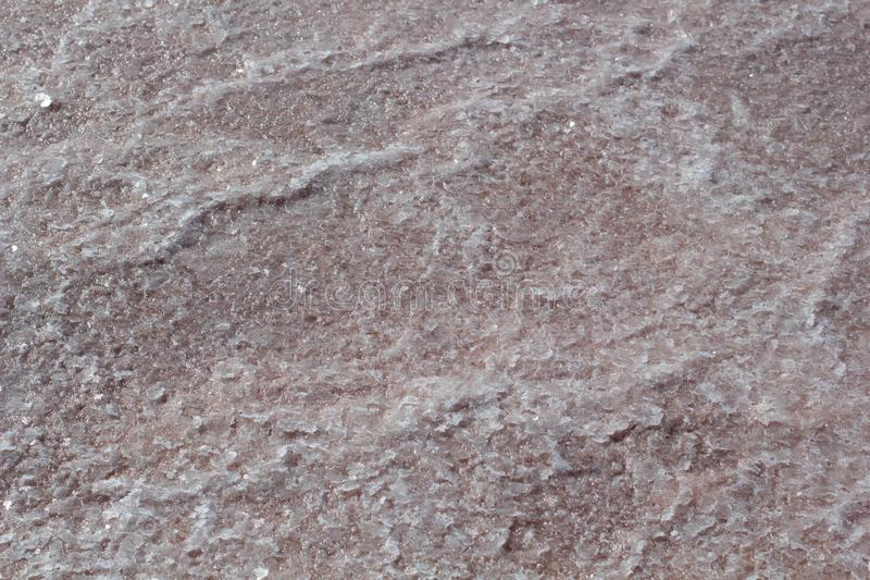 Natural pink salt crystal texture on the sand, macro, close up, lamellar structure. Salty lake shore background. Spain, Torrevieja stock photos