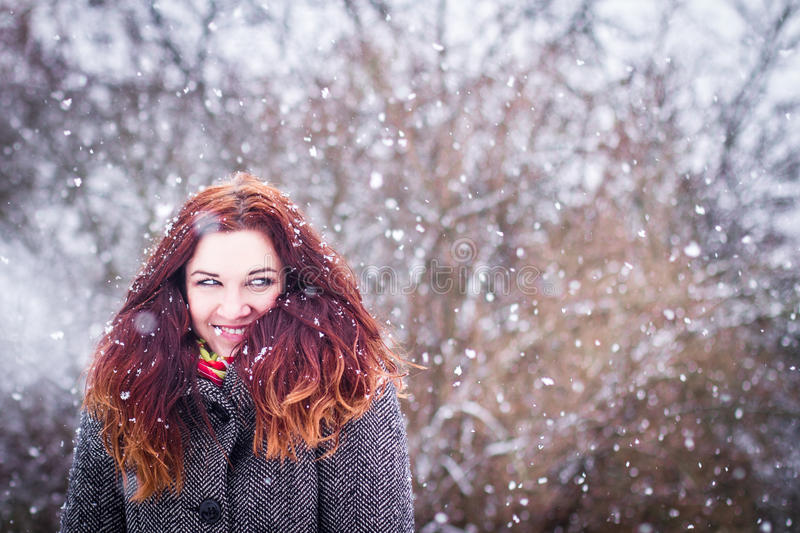 Natural portarit of young woman in snowy weather stock photography