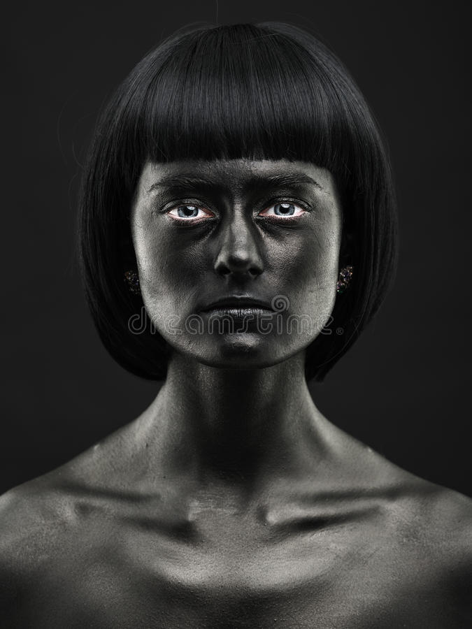 Natural portrait of a dark-skinned beautiful girl. Black Beauty. Face. No photoshop stock photo
