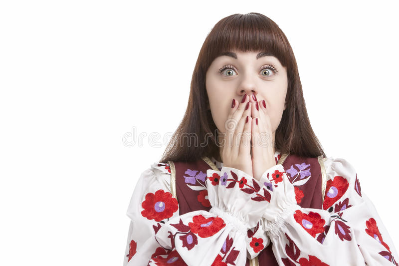 Natural Portrait of Frightened Caucasian Female. Posing with Hands Closing Mouth. Against Pure White. Horizontal Image Orientation royalty free stock image