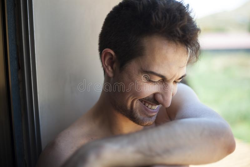 Natural portrait shot of young man smiling royalty free stock photo