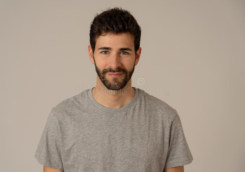 Natural portrait of young attractive man in his 20s looking and posing with neutral face expression. Close up headshot of young caucasian man with natural and royalty free stock photography