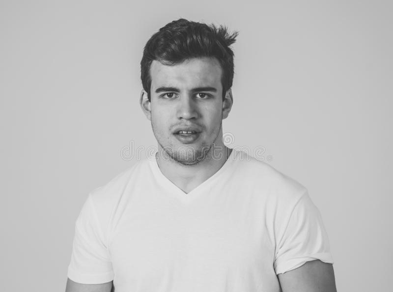 Natural portrait of young attractive man in his 20s looking and posing with neutral face expression. Close up headshot of young latin man with natural and royalty free stock photography