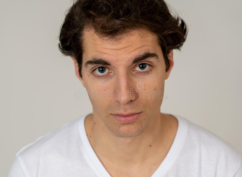 Natural portrait of young attractive man in his 20s looking and posing with neutral face expression. Close up headshot of young latin man with natural and royalty free stock photos