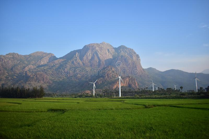 Natural Pride crop land mountain wind mill sky stock images