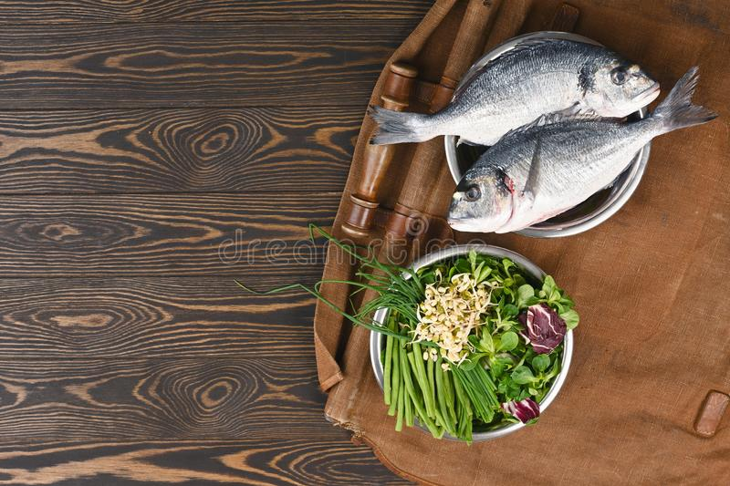Natural raw ingredients for healthy pet food ingredients in individual bowls on brown wooden background. stock images