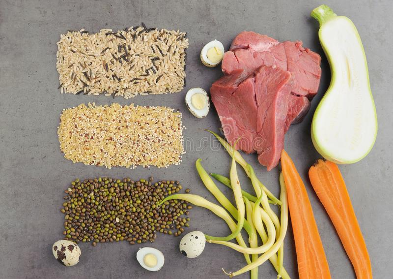 Natural raw ingredients for pet food on grey background. royalty free stock photos