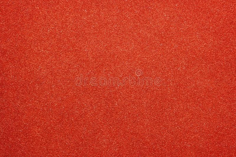 Red colored glitter paper abstract or vintage texture background. Natural red colored glitter paper abstract or vintage texture background stock image