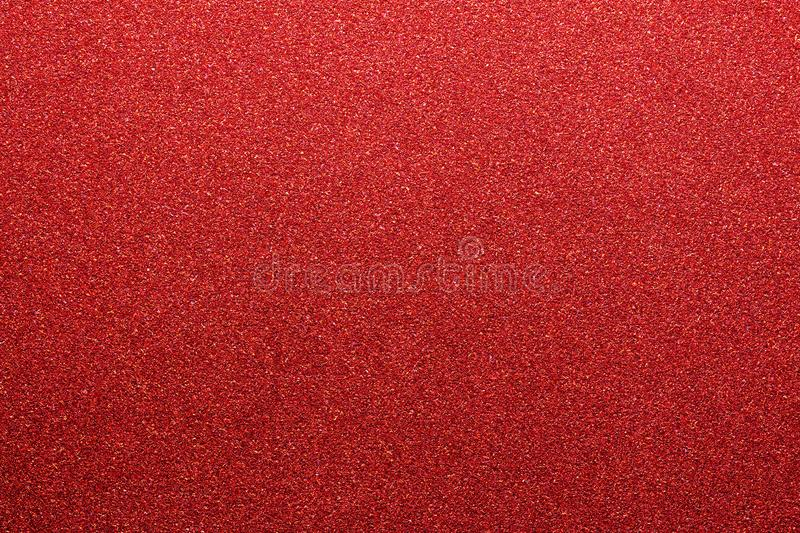 Red colored glitter paper texture or vintage background stock photography