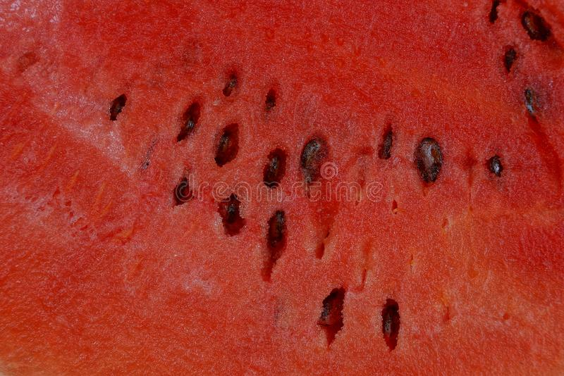 Natural red texture of a piece of ripe fresh watermelon royalty free stock photography