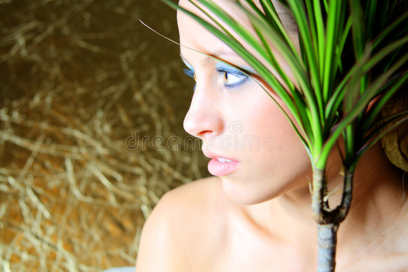 Natural resources and human. Woman caring plant in flowerpot stock image