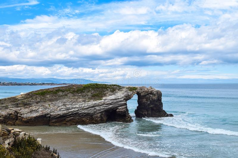 Natural rock arches on Cathedrals beach royalty free stock images