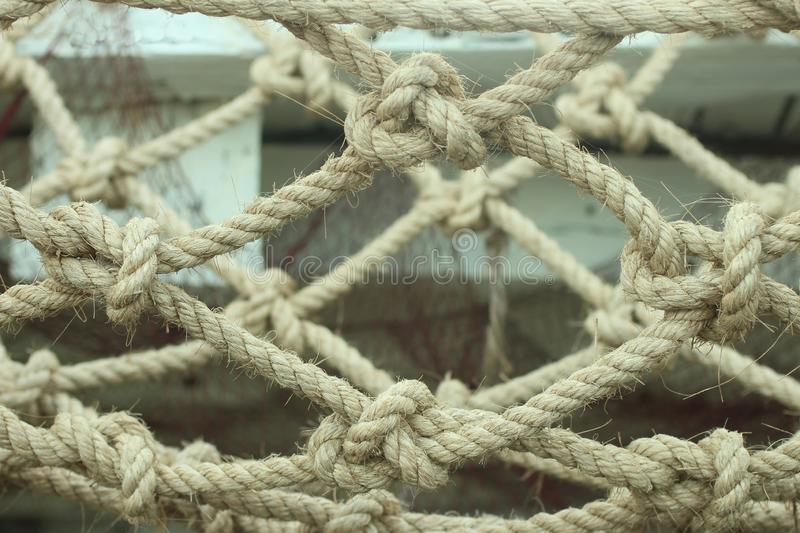 Natural rope tied to one another for stronger bonds. Bond at the end of the rope. Team work and leader concept. Natural rope stock photos
