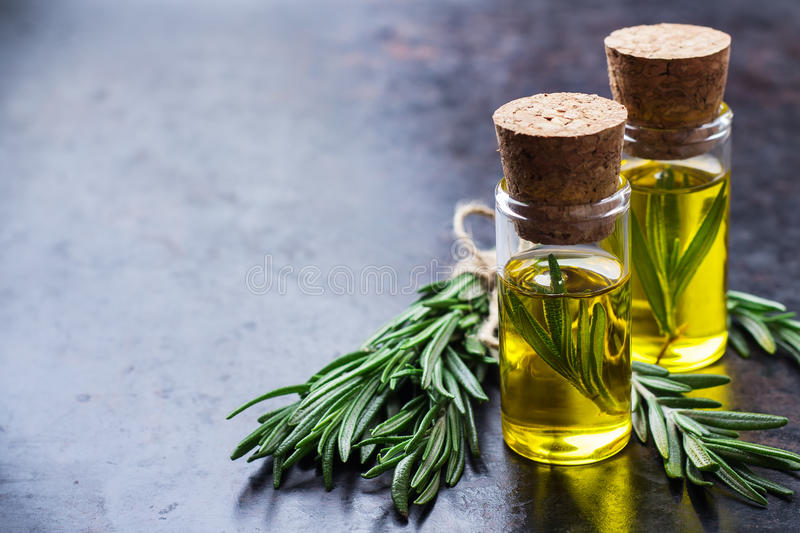 Natural rosemary essential oil for beauty and spa stock image