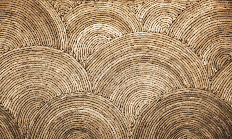 Natural round wicker pattern background. Texture royalty free stock photo