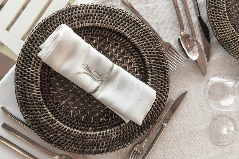 Natural rustic style wedding table decoration and cutlery detail royalty free stock images