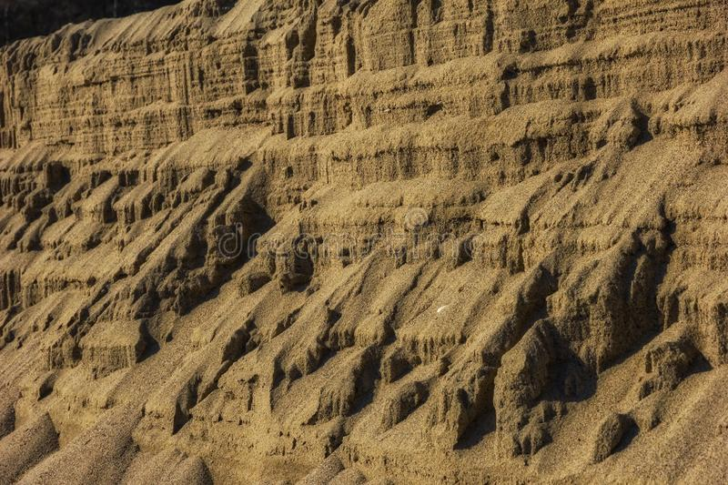 Natural sand abstract forming a textured background. Close up stock photo