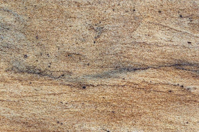 Natural sand stone texture and seamless background stock image