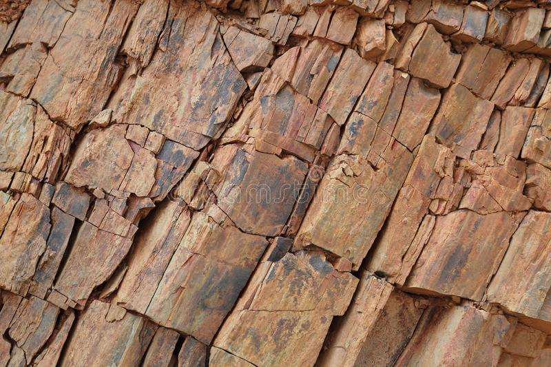 Natural sand stone walling with rough surface for artistic background design purpose. Natural sand stone walling with rough surface for artistic background royalty free stock photography