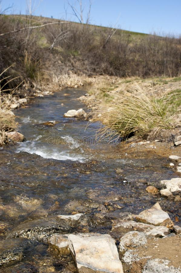 Natural scene of the course of a stream stock photography