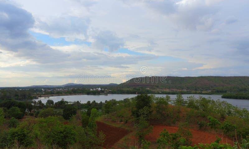 Natural scenery, kagdi pick up lake, Banswara, rajasthan. india. Cloud in blue sky, green mountain and tree, lake water and om sai temple providing natural stock images